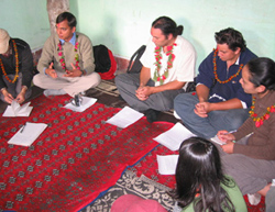 Meeting with youth in a Nepalese village in 2007 with two young people I took over to share the experience.